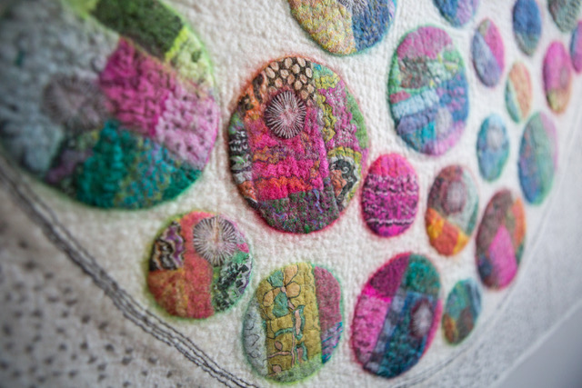 Felt wall hanging with multicoloured marble-like images